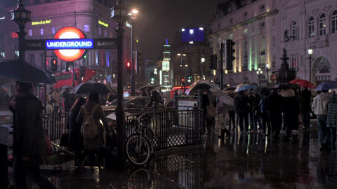 Piccadilly Circus tube station on a rainy night in London Footage
