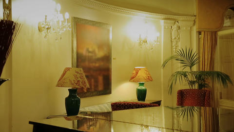 Lacquered piano standing in luxury room in dim yellow light, expensive dwelling Footage