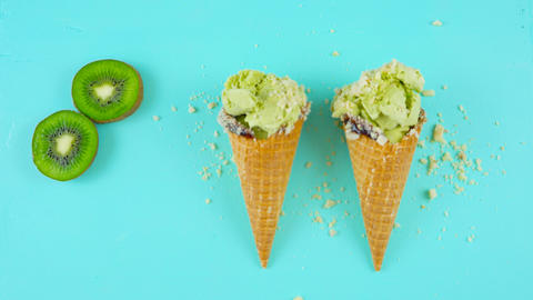 Preparing Matcha Green Tea ice cream cones with crushed nuts and chocolate, on Footage