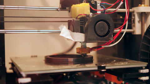 3D Printing Process with Plastic Wire Filament on Printer. 4K Footage