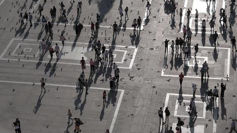 Milan, Italy - Slow motion of people walking in Duomo square ビデオ