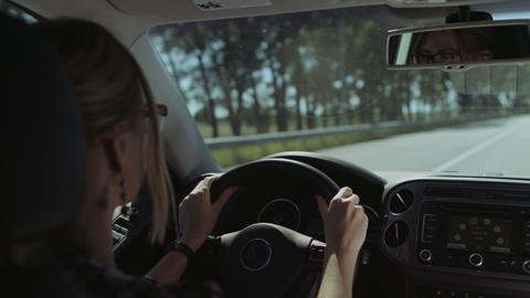 Beautiful female driver driving car on motorway Footage