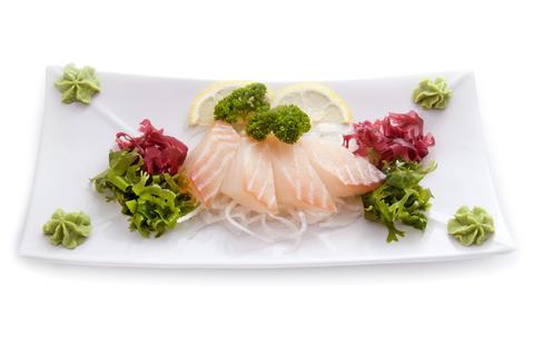 Cutting raw white fish salad wasabi isolated Photo