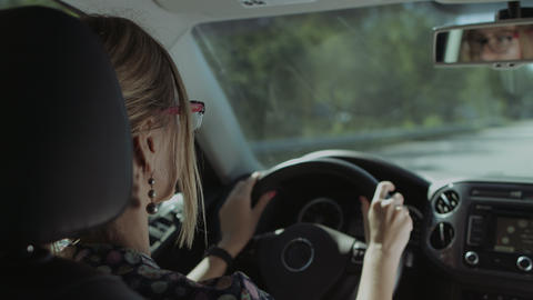 Female driver is reflected in car rear view mirror Footage