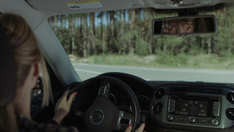 Woman driving car and making a turn on highway Footage