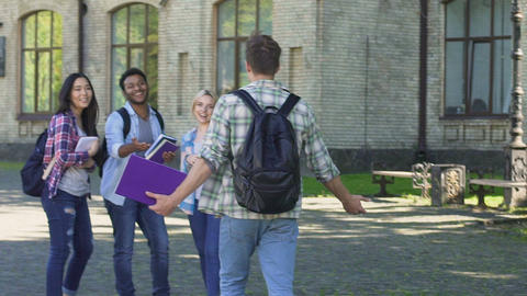 Student walking to best friends waiting him near... Stock Video Footage