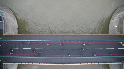 Cyclists flow across Tower Bridge Footage
