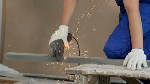 Industrial worker cutting metal with many sharp sparks at construction site Footage