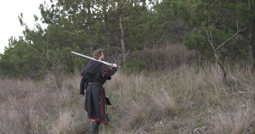 Warrior with sword go straight to pine forest Live Action