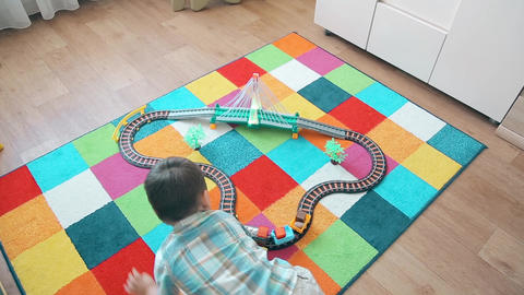 A little boy plays in the train, running after him to overtake Footage