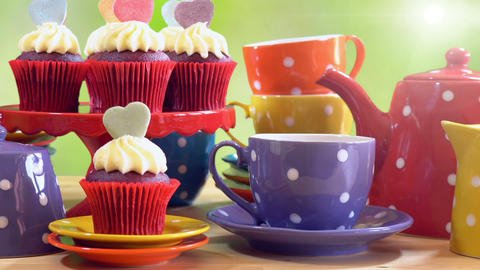 Colorful Mad Hatter style tea party with cupcakes and rainbow colored polka dot Live Action