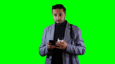 Man in suit a use mobile and hold coffee cup. Green screen, footage Footage
