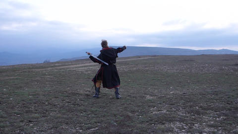 Training before the battle A bearded man in armor and tunic Live Action