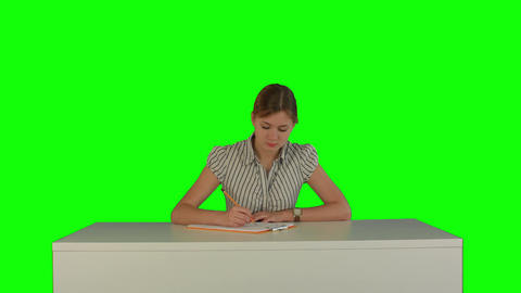 Young girl sitting in classroom at lecture and listening teacher on a Green Footage