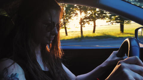 Beautiful cheerful woman driving a car, beautiful scenery... Stock Video Footage