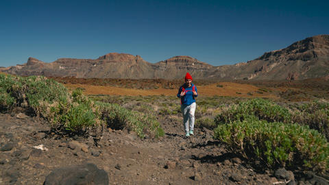 Active hiker woman hiking on Teide National Park. Caucasian young woman with Footage