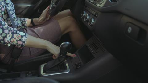 Female hand pressing start engine button in car Footage