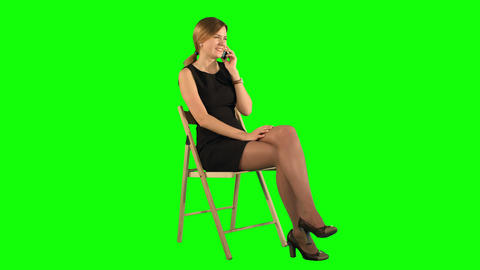 Young Business Woman Using Telephone on a Green Screen Footage