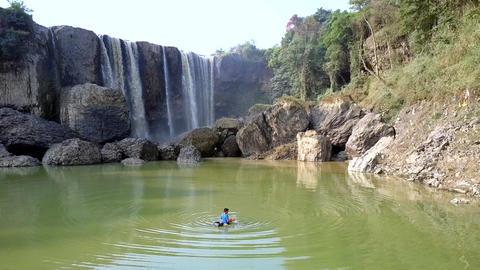 numerous waterfall streams run from height on rocks Footage