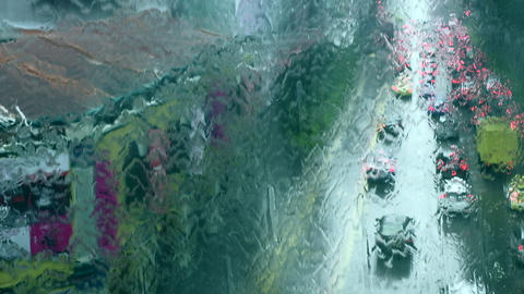 Singapore - Elevated view of traffic viewed through window with rain water flowing down. 4K Live Action