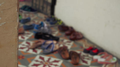 Singapore - Defocused shoes at five foot way of traditional shophouse Pedestal camera movement. Live Action