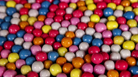 Candies. Sugar coated bonbons candy background mini footage video clip Footage