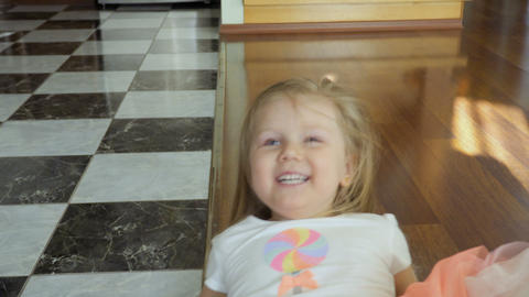 Little girl has fun at home Footage