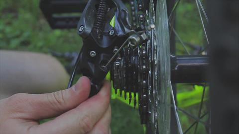 bike assembly. Mechanic repairing wheel in bicycle's workshop. Mechanic GIF