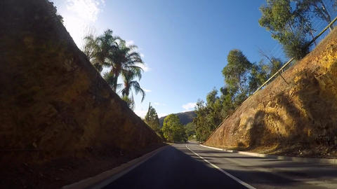 Vehicle POV, driving along mountain road, early morning, time lapse Footage