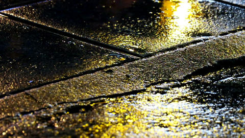 Seamless loop of warning light reflection on wet street Footage