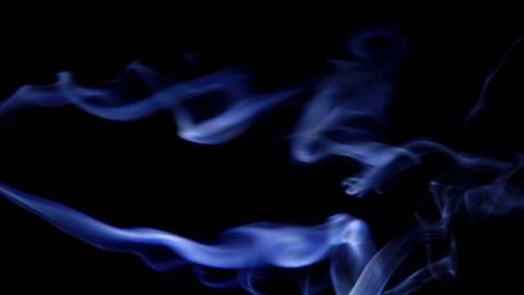 sidestream blue smoke in the dark Footage
