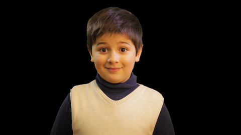 young handsome child boy look to camera GIF