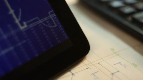 Tablet PC with drawings on the table with Blueprints GIF