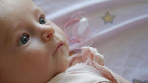 Close up of a happy three month old baby girl GIF