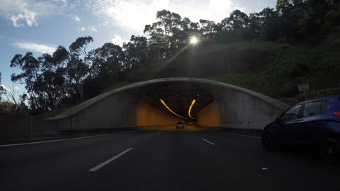 4K vehicle POV driving through freeway tunnel, time lapse Footage