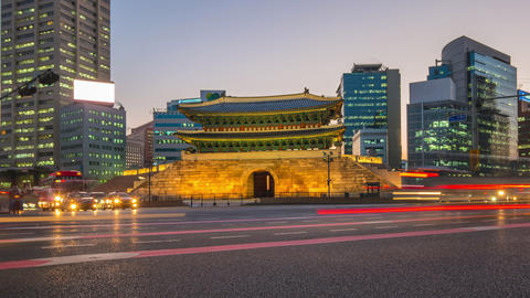 Namdaemun Gate with seoul traffic street at night in Seoul, South Korea Time Live Action