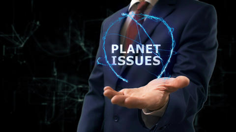 Businessman shows concept hologram Planet issues on his hand Live Action
