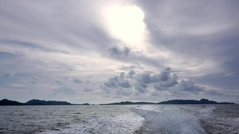 Clouds and Trace Behind the Stern of a Motor Boat GIF
