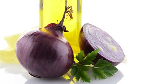 Red onion and olive oil still Stock Video Footage