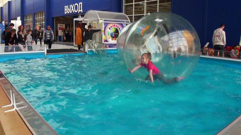 Children in spheres on water Stock Video Footage