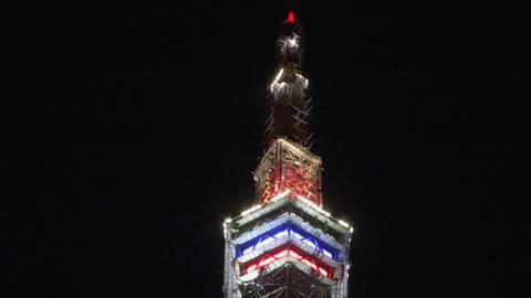 Television tower at night decorated with fires Footage
