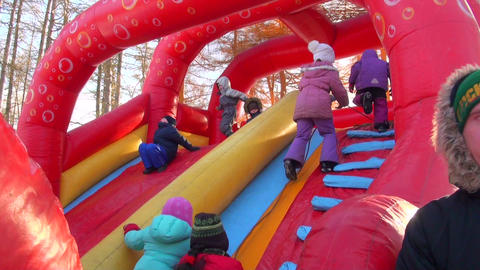 Children on an inflatable trampoline Stock Video Footage
