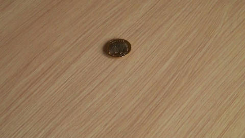 Coins on table Stock Video Footage