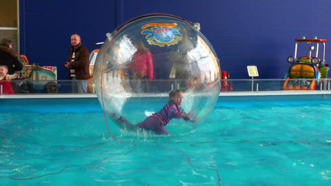 Children in spheres on water Footage