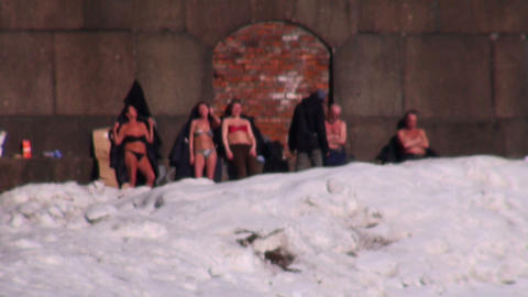 Sunbathing people in the snow Stock Video Footage