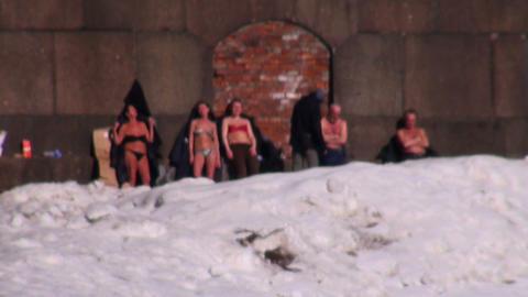 Sunbathing people in the snow Stock Video Footage