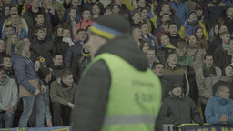 Stuart looks at the fans in the stadium Footage