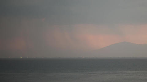 Timelapse of thunderstorm over the sea and city Footage