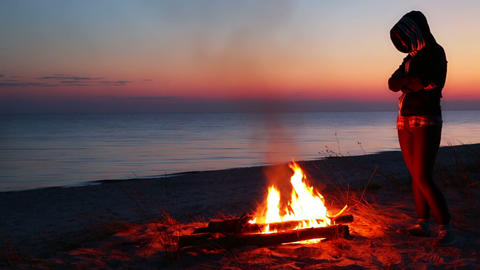 Sunset on the Beach. One Girl and the Campfire Footage