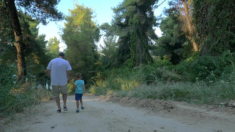 Grandson and grandfather running in the woods Footage